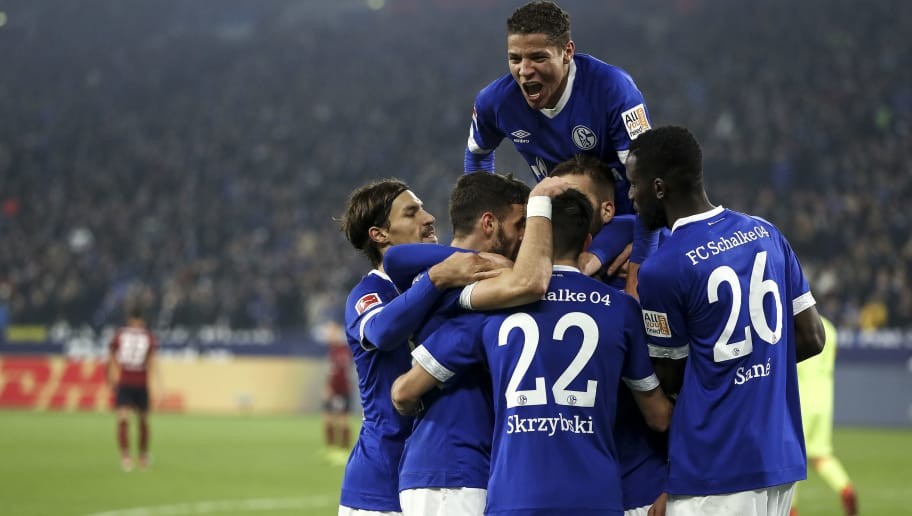 GELSENKIRCHEN, GERMANY - NOVEMBER 24: Guido Burgstaller #19 of FC Schalke 04 celebrates with teammates after scoring his team's third goal during the Bundesliga match between FC Schalke 04 and 1. FC Nuernberg at Veltins-Arena on November 24, 2018 in Gelsenkirchen, Germany.  (Photo by Maja Hitij/Bongarts/Getty Images)