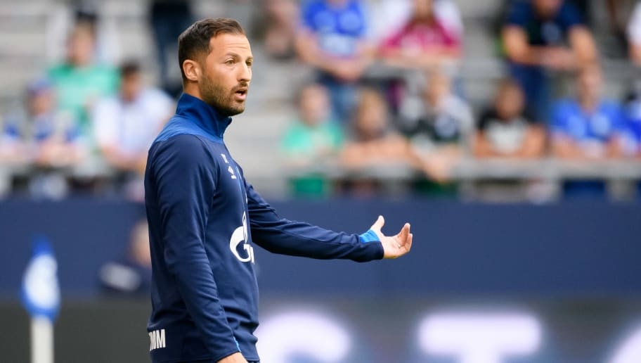 GELSENKIRCHEN, GERMANY - AUGUST 11: Head coach Domenico Tedesco of Schalke looks on during the friendly match between FC Schalke 04 and AFC Fiorentina at Veltins Arena on August 11, 2018 in Gelsenkirchen, Germany. (Photo by TF-Images/Getty Images)