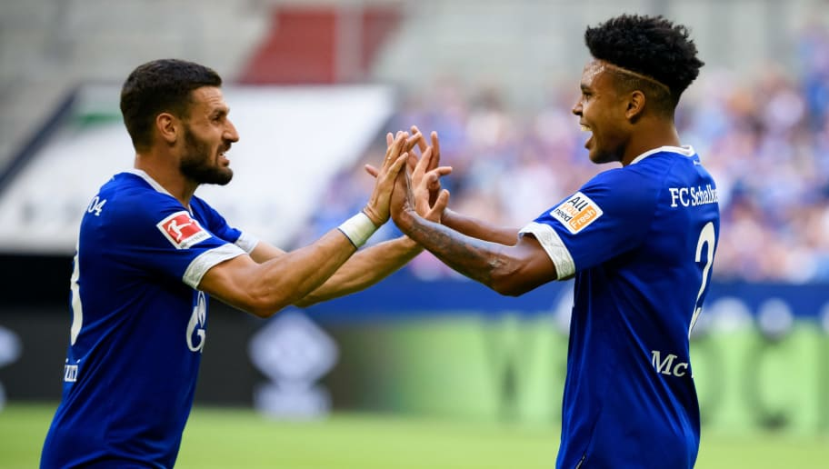 GELSENKIRCHEN, GERMANY - AUGUST 11: Weston McKennie of Schalke celebrates after scoring his team`s first goal with Daniel Caligiuri of Schalke during the friendly match between FC Schalke 04 and AFC Fiorentina at Veltins Arena on August 11, 2018 in Gelsenkirchen, Germany. (Photo by TF-Images/Getty Images)