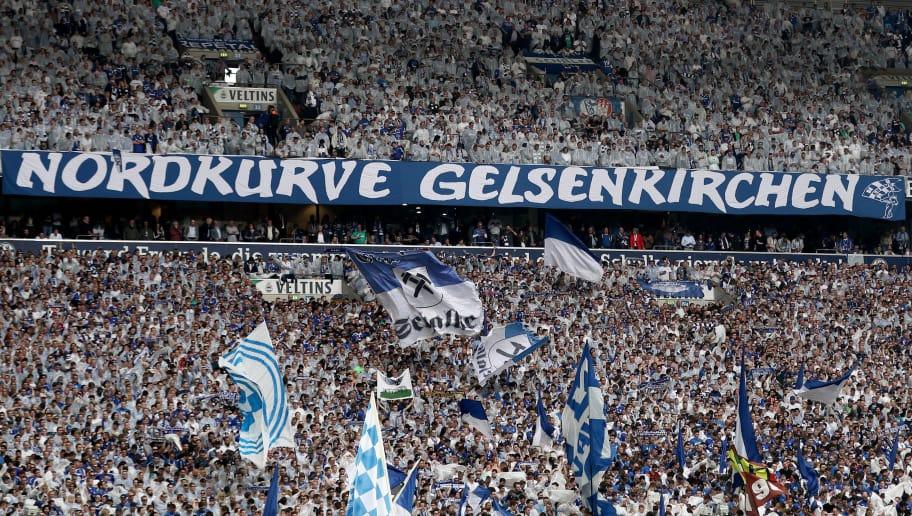 GELSENKIRCHEN, GERMANY - APRIL 15: View of the Nordkurve during the Bundesliga match between FC Schalke 04 and Borussia Dortmund at Veltins-Arena on April 15, 2018 in Gelsenkirchen, Germany. (Photo by Christof Koepsel/Bongarts/Getty Images)