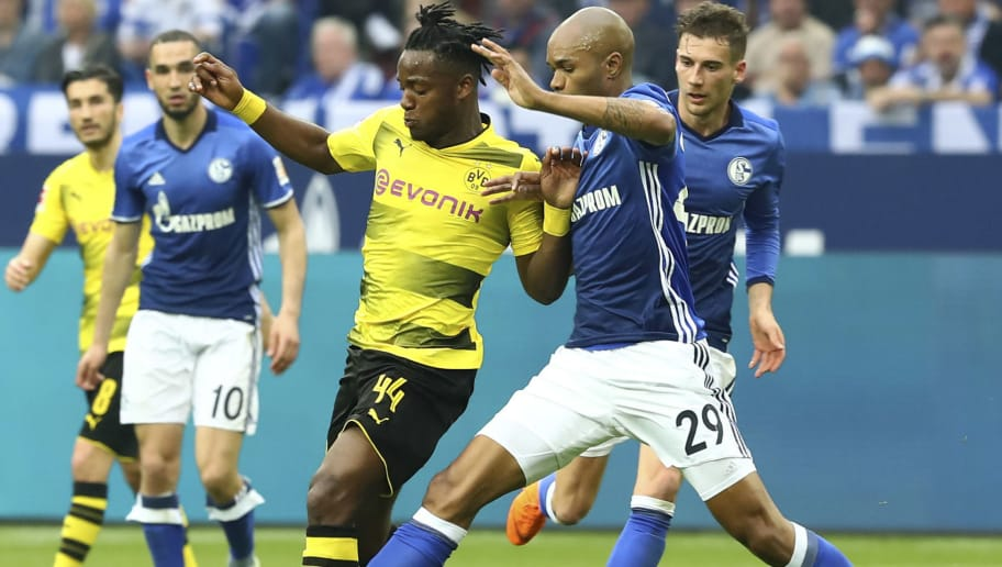GELSENKIRCHEN, GERMANY - APRIL 15: Michy Batshuayi of Dortmund and Naldo, Ronaldo Aparecido Rodrigues of Schalke battle for the ball during the Bundesliga match between FC Schalke 04 and Borussia Dortmund at Veltins-Arena on April 15, 2018 in Gelsenkirchen, Germany. (Photo by TF-Images/Getty Images)