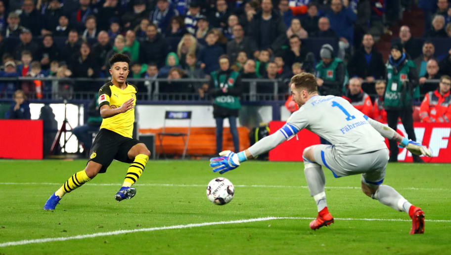 GELSENKIRCHEN, GERMANY - DECEMBER 08:  Jadon Sancho of Borussia Dortmund scores his team's second goal during the Bundesliga match between FC Schalke 04 and Borussia Dortmund at Veltins-Arena on December 8, 2018 in Gelsenkirchen, Germany.  (Photo by Lars Baron/Bongarts/Getty Images)
