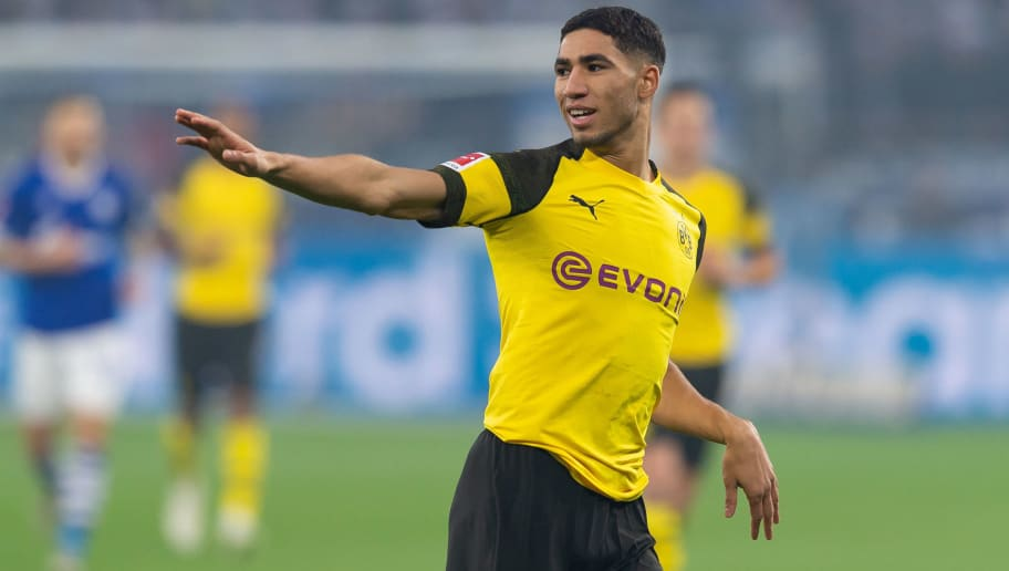 GELSENKIRCHEN, GERMANY - DECEMBER 08: Achraf Hakimi of Dortmund gestures during the Bundesliga match between FC Schalke 04 and Borussia Dortmund at the Veltins Arena on December 08, 2018 in Dortmund, Germany. (Photo by TF-Images/TF-Images via Getty Images)