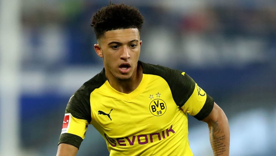 GELSENKIRCHEN, GERMANY - DECEMBER 08: Jadon Sancho of Dortmund runs with the ball during the Bundesliga match between FC Schalke 04 and Borussia Dortmund at Veltins-Arena on December 08, 2018 in Gelsenkirchen, Germany. (Photo by Lars Baron/Bongarts/Getty Images)