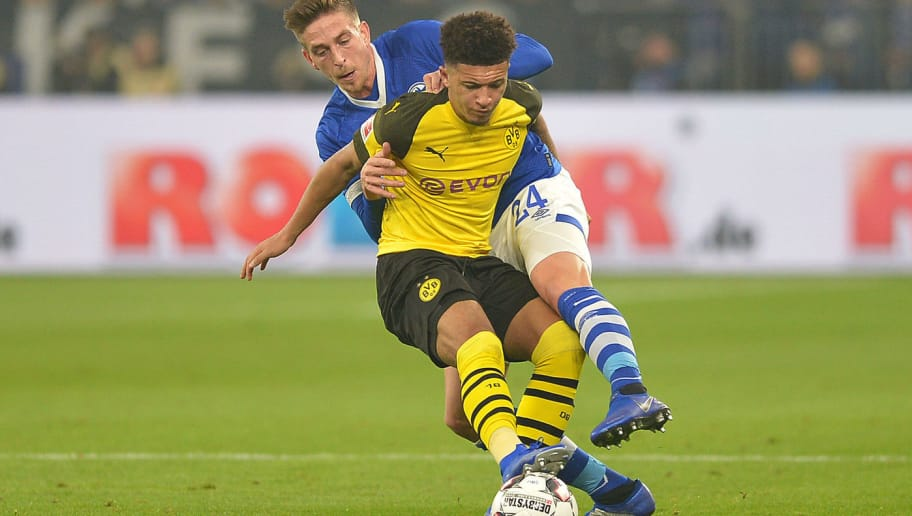GELSENKIRCHEN, GERMANY - DECEMBER 08: Jadon Sancho of Dortmund and Bastian Oczipka of Schalke battle for the ball during the Bundesliga match between FC Schalke 04 and Borussia Dortmund at Veltins-Arena on December 8, 2018 in Gelsenkirchen, Germany. (Photo by TF-Images/TF-Images via Getty Images)