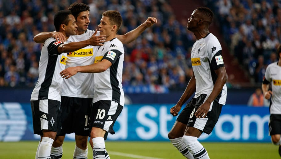 GELSENKIRCHEN, GERMANY - APRIL 28:  Raffael of Moenchengladbach celebrates with team mates after scoring his teams first goal  during the Bundesliga match between FC Schalke 04 and Borussia Moenchengladbach at Veltins-Arena on April 28, 2018 in Gelsenkirchen, Germany.  (Photo by Lars Baron/Bongarts/Getty Images)