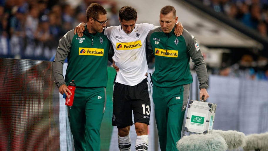 GELSENKIRCHEN, GERMANY - APRIL 28:  Lars Stindl of Moenchengladbach leaves injured the pitch during the Bundesliga match between FC Schalke 04 and Borussia Moenchengladbach at Veltins-Arena on April 28, 2018 in Gelsenkirchen, Germany.  (Photo by Lars Baron/Bongarts/Getty Images)