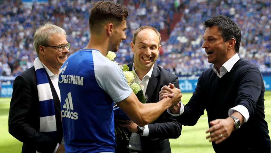 GELSENKIRCHEN, GERMANY - MAY 12: Manager Christian hides of Schalke says farewell to Leon Goretzka prior to the Bundesliga match between FC Schalke 04 and Eintracht Frankfurt at Veltins-Arena on May 12, 2018 in Gelsenkirchen, Germany. (Photo by Christof Koepsel/Bongarts/Getty Images)