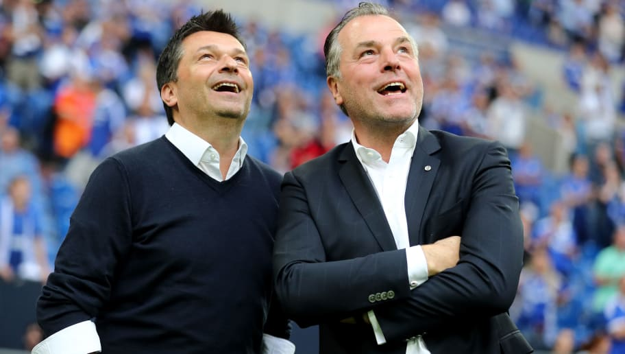 GELSENKIRCHEN, GERMANY - MAY 12: (L-R) Manager Christian hooded and Clemens Toennies, chairman of the board smile after winning 1-0 the Bundesliga match between FC Schalke 04 and Eintracht Frankfurt at Veltins-Arena on May 12, 2018 in Gelsenkirchen, Germany. (Photo by Christof Koepsel/Bongarts/Getty Images)