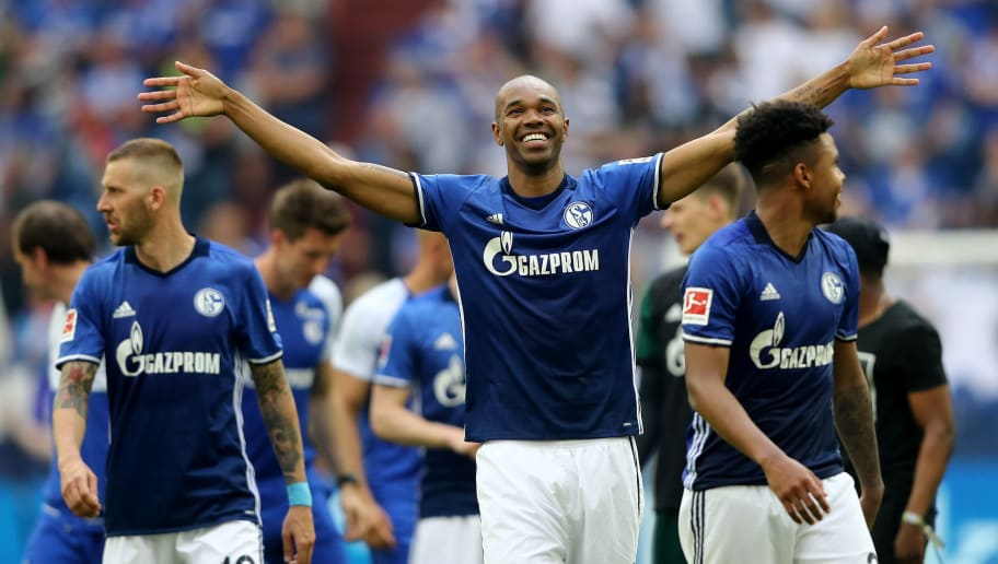 GELSENKIRCHEN, GERMANY - MAY 12: Naldo of Schalke and his team celebrates after winning 1-0 the Bundesliga match between FC Schalke 04 and Eintracht Frankfurt at Veltins-Arena on May 12, 2018 in Gelsenkirchen, Germany. (Photo by Christof Koepsel/Bongarts/Getty Images)