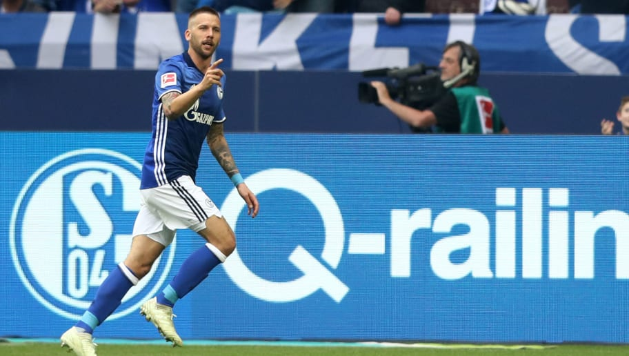 GELSENKIRCHEN, GERMANY - MAY 12: lGuido Burgstaller of Schalke celebrates the first goal during the Bundesliga match between FC Schalke 04 and Eintracht Frankfurt at Veltins-Arena on May 12, 2018 in Gelsenkirchen, Germany. (Photo by Christof Koepsel/Bongarts/Getty Images)