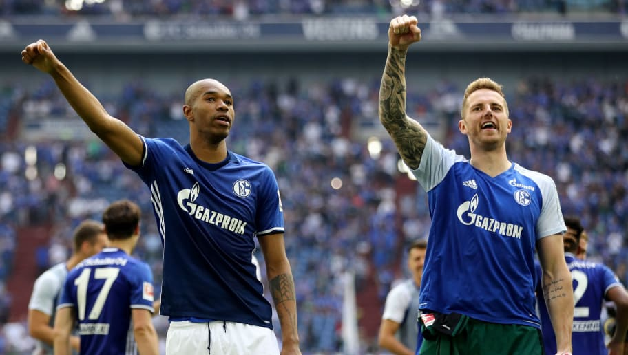 GELSENKIRCHEN, GERMANY - MAY 12: (L-R) Naldo and Ralf Faehrmann of Schalke celebrate after winning 1-0 the Bundesliga match between FC Schalke 04 and Eintracht Frankfurt at Veltins-Arena on May 12, 2018 in Gelsenkirchen, Germany. (Photo by Christof Koepsel/Bongarts/Getty Images)