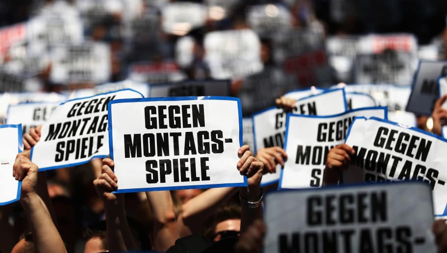 GELSENKIRCHEN, GERMANY - MAY 07:  Fans hold up signs saying 'Gegen Montags Spiele' protesting the planned Monday night matches for next season during the Bundesliga match between FC Schalke 04 and FC Augsburg held at Veltins-Arena on May 7, 2016 in Gelsenkirchen, Germany.  (Photo by Dean Mouhtaropoulos/Bongarts/Getty Images)