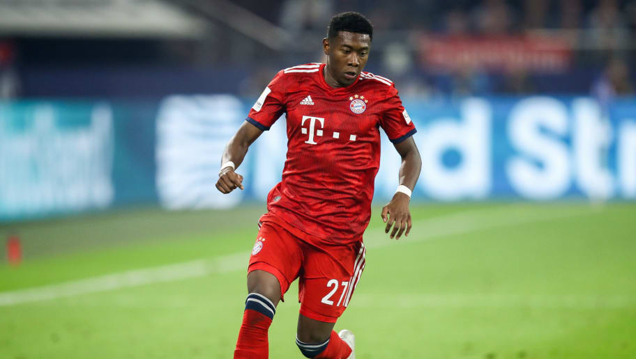 GELSENKIRCHEN, GERMANY - SEPTEMBER 22: David Alaba #27 of Bayern Munich controls the ball during the Bundesliga match between FC Schalke 04 and FC Bayern Muenchen at Veltins-Arena on September 22, 2018 in Gelsenkirchen, Germany. (Photo by Maja Hitij/Bongarts/Getty Images)