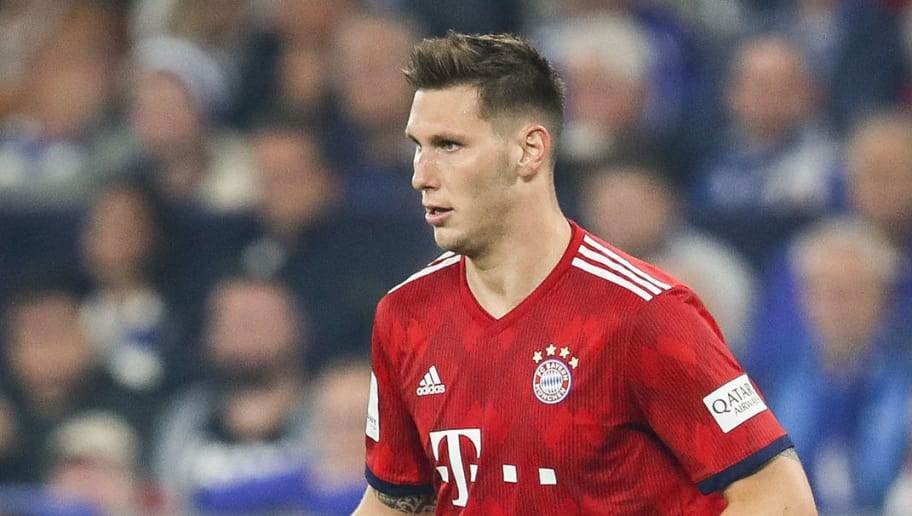 GELSENKIRCHEN, GERMANY - SEPTEMBER 22: Niklas Sule #4 of Bayern Munich controls the ball during the Bundesliga match between FC Schalke 04 and FC Bayern Muenchen at Veltins-Arena on September 22, 2018 in Gelsenkirchen, Germany. (Photo by Maja Hitij/Bongarts/Getty Images)