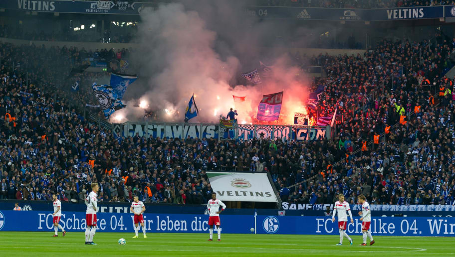 GELSENKIRCHEN, GERMANY - NOVEMBER 19: Supporters of Hamburg fire up bengalo / pyro / firework during the Bundesliga match between FC Schalke 04 and Hamburger SV at Veltins-Arena on November 19, 2017 in Gelsenkirchen, Germany. (Photo by TF-Images/TF-Images via Getty Images)