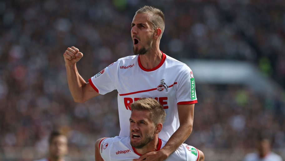 HAMBURG, GERMANY - SEPTEMBER 02: Simon Terodde of  FC Koeln  celebrates after scoring his team`s third goal  with  Dominick Drexler of  FC Koeln  zum Tor zum 2:3 per Foulelfmeter during the Second Bundesliga match between FC St. Pauli and 1. FC Koeln on September 2, 2018 in Hamburg, Germany. (Photo by TF-Images/Getty Images)