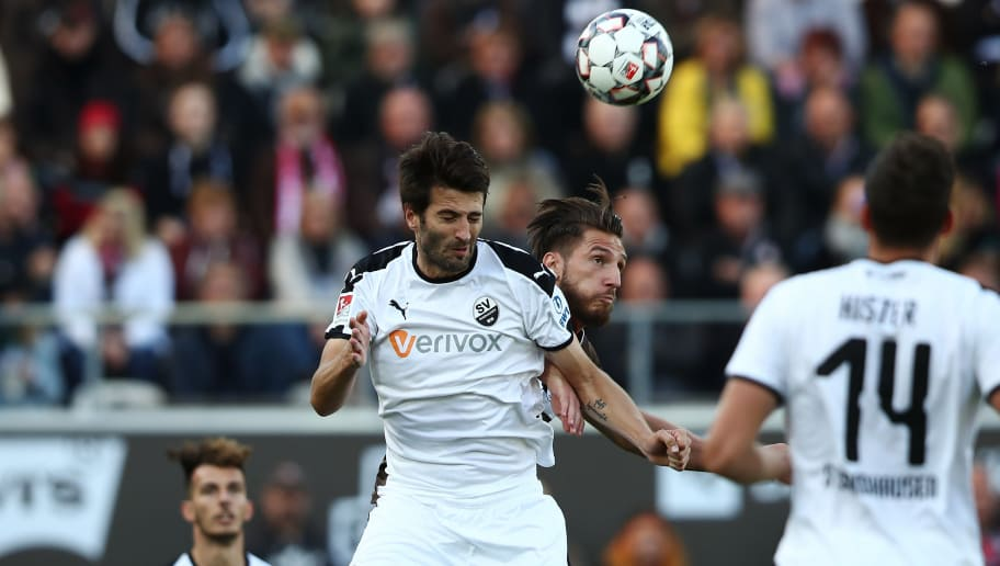HAMBURG, GERMANY - OCTOBER 07: Dimitrios Diamantakos (R) of Pauli and Markus Karl (L) of Sandhausen compete for the ball during the Second Bundesliga match between FC St. Pauli and SV Sandhausen at Millerntor Stadium on October 7, 2018 in Hamburg, Germany. (Photo by Oliver Hardt/Bongarts/Getty Images)