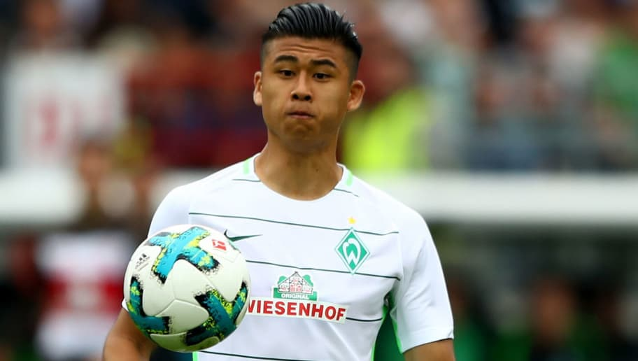 HAMBURG, GERMANY - JULY 22: Yuning Zhang of Bremen runs with the ball during the preseason friendly match between FC St. Pauli and Werder Bremen at Millerntor Stadium on July 22, 2017 in Hamburg, Germany.  (Photo by Martin Rose/Bongarts/Getty Images)