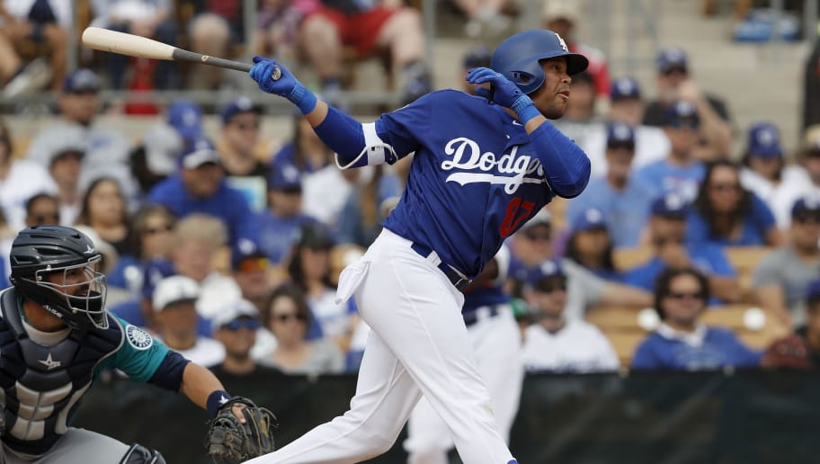 GLENDALE, AZ - MARCH 05: Jose Miguel Fernandez #87 of the Los Angeles Dodgers hits a sacrifice fly scoring a run in the seventh inning against the Seattle Mariners during the spring training game at Camelback Ranch on March 5, 2017 in Glendale, Arizona. (Photo by Tim Warner/Getty Images)