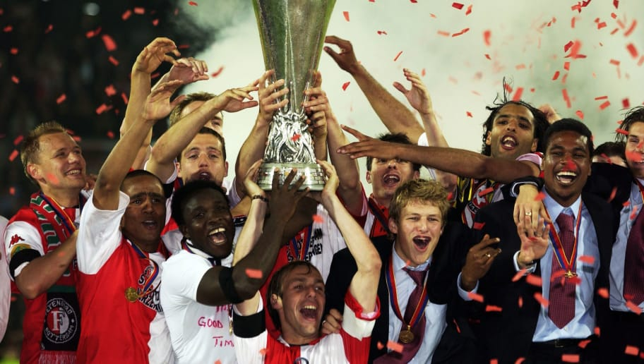 ROTTERDAM - MAY 8:  Feyenoord players celebrate winning the cup after the UEFA Cup Final between Feyenoord and Borussia Dortmund played at the De Kuip Stadium, in Rotterdam, Holland on May 8, 2002. Feyenoord won the match and cup 3-2.  DIGITAL IMAGE. (Photo by Jamie McDonald/Getty Images)