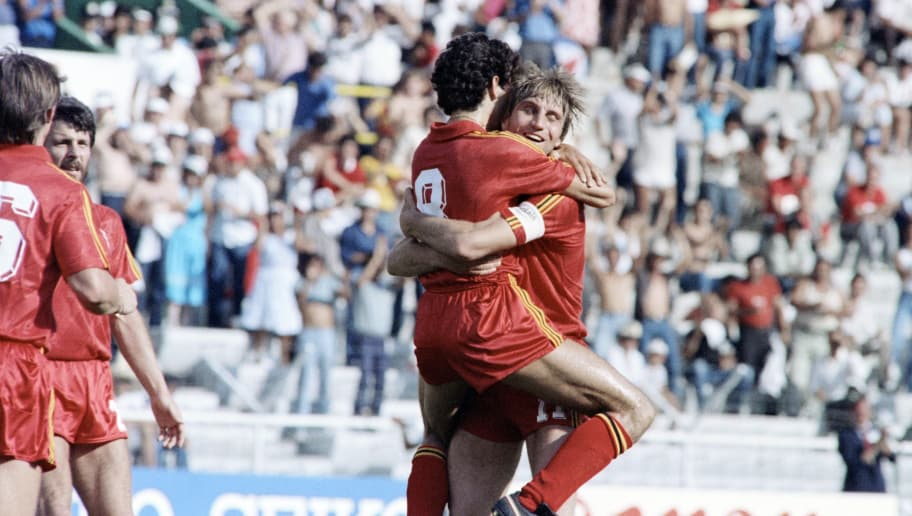 FIFA WORLD CUP 1986 1/8 final match between Soviet Union (white shirts) and Belgium, in Leon, Mexico, on June 15, 1986. Belgium players hug each other after their  football team won the match 04-03. World Cup was won by Argentina (their second title, after also winning in 1978), led by Diego Maradona. AFP PHOTO (Photo credit should read -/AFP/Getty Images)