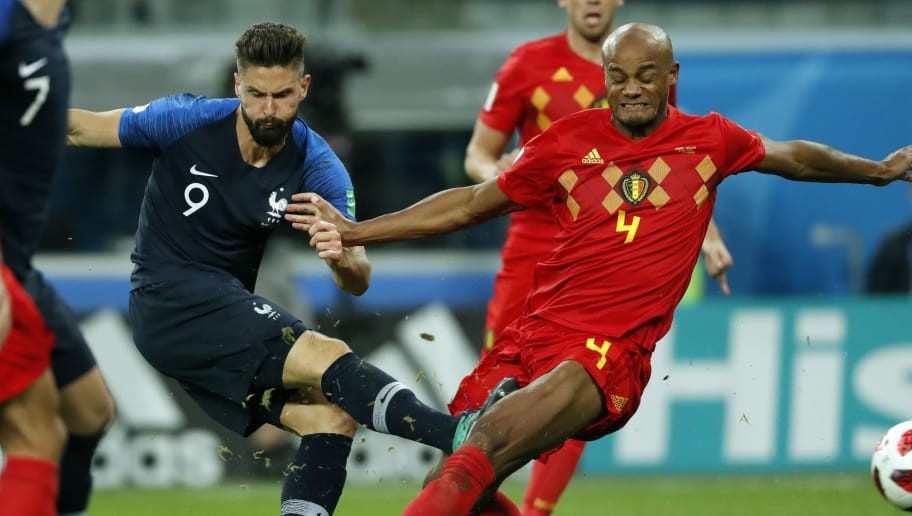 (l-r) Olivier Giroud of France, Vincent Kompany of Belgium during the 2018 FIFA World Cup Semi Final match between France and Belgium at the Saint Petersburg Stadium on June 26, 2018 in Saint Petersburg, Russia(Photo by VI Images via Getty Images)