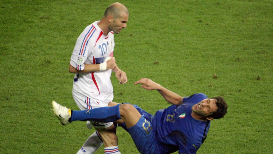 FILES - A photo taken 09 July 2006 shows French midfielder Zinedine Zidane (L) gesturing after head-butting Italian defender Marco Materazzi during the World Cup 2006 final football match between Italy and France at Berlin?s Olympic Stadium. Materazzi said in an interview in German sports magazine 'Sports Bild' published 01August 2007 that he has tried several times to arrange a meeting with Zinedine Zidane, but the Frenchman who head-butted him in the 2006 World Cup final has always refused to meet him. AFP PHOTO  JOHN MACDOUGALL (Photo credit should read JOHN MACDOUGALL/AFP/Getty Images)