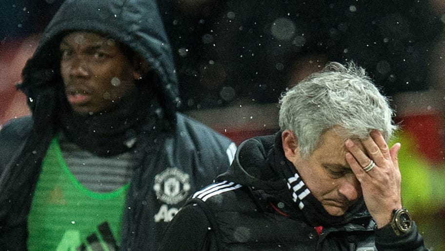(FILES) in this March 17, 2018 file photo, Manchester United's Portuguese manager Jose Mourinho (R) and French midfielder Paul Pogba leave after the English FA Cup quarter-final football match between Manchester United and Brighton and Hove Albion at Old Trafford in Manchester, north west England. - Paul Pogba has been told by Manchester United manager Jose Mourinho he will never captain the club again while the Portuguese remains in charge, according to reports on September 25, 2018, as tensions between United's star midfielder and manager continue to rise. (Photo by Oli SCARFF / AFP) / RESTRICTED TO EDITORIAL USE. No use with unauthorized audio, video, data, fixture lists, club/league logos or 'live' services. Online in-match use limited to 75 images, no video emulation. No use in betting, games or single club/league/player publications. /         (Photo credit should read OLI SCARFF/AFP/Getty Images)