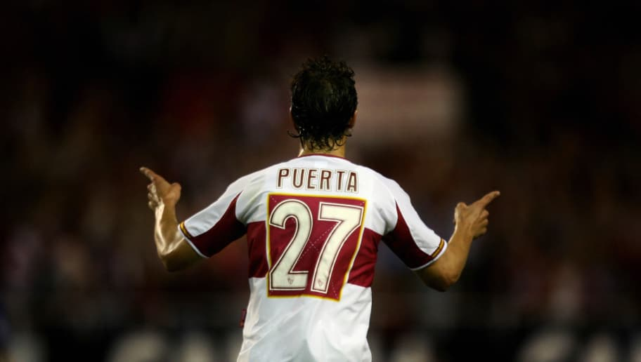 (FILES) Photo taken 27 April 2006 of Sevilla's Antonio Puerta celebrating after scoring against Schalke during a UEFA Cup football match at the Sanchez Pizjuan stadium in Seville. Puerta died 28 August 2007 after suffering a heart attack during a Spanish league match on Saturday. The prolonged cardiac arrest had damaged Puerta's organs and led to a lack of oxygen to the brain. AFP PHOTO/ JOS? LUIS ROCA. (Photo credit should read JOSE LUIS ROCA/AFP/Getty Images)