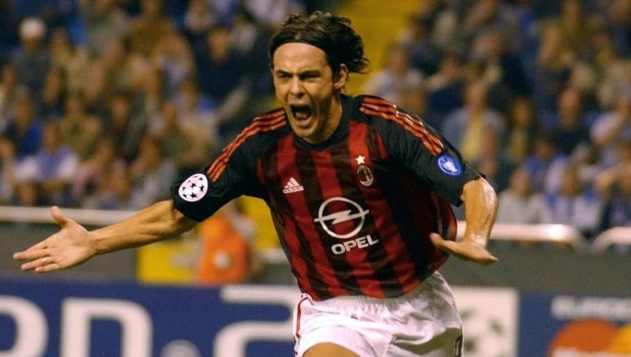 LA CORU?A, SPAIN:  Milan AC's Filipo Inzaghi celebrates after scoring the second goal against Deportivo La Coruna during their champions League match 24 September 2002, in Riazor stadium in La Coruna. AFP PHOTO Christophe SIMON. (Photo credit should read CHRISTOPHE SIMON/AFP/Getty Images)