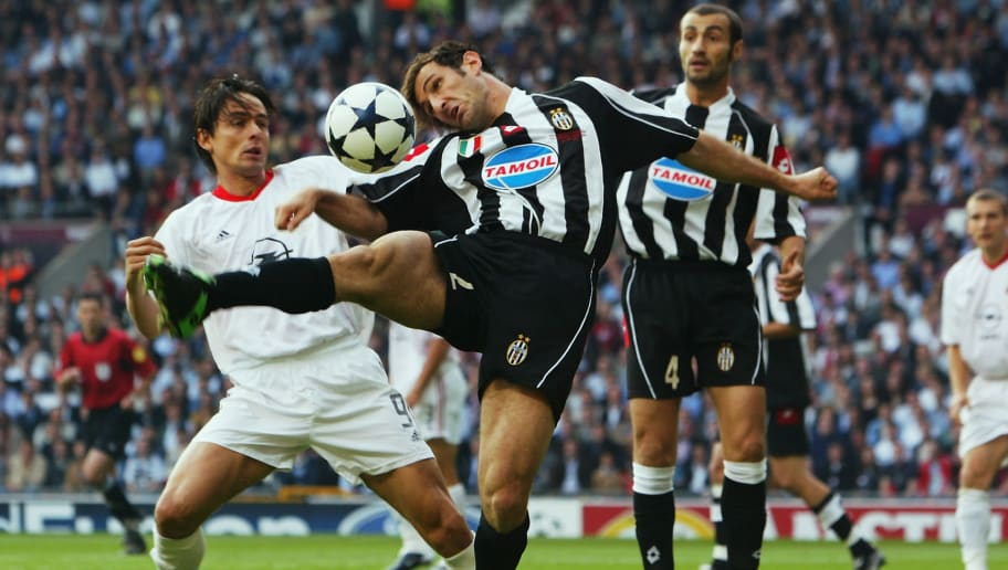 Filippo Inzaghi of AC Milan and Ciro Ferrara of Juventus tussle for posession of the ball