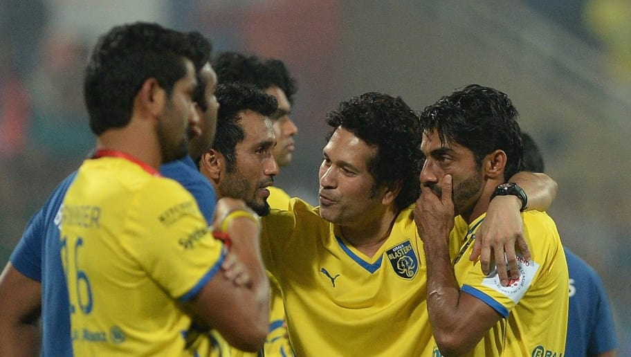 Indian cricketer Sachin Tendulkar (2nd R) interacts with Kerala Blasters players after Atletico de Kolkata won the Indian Super League (ISL) final football match against Kerala Blasters at The D.Y. Patil stadium in Navi Mumbai on December 20, 2014.   AFP PHOTO/ PUNIT PARANJPE        (Photo credit should read PUNIT PARANJPE/AFP/Getty Images)