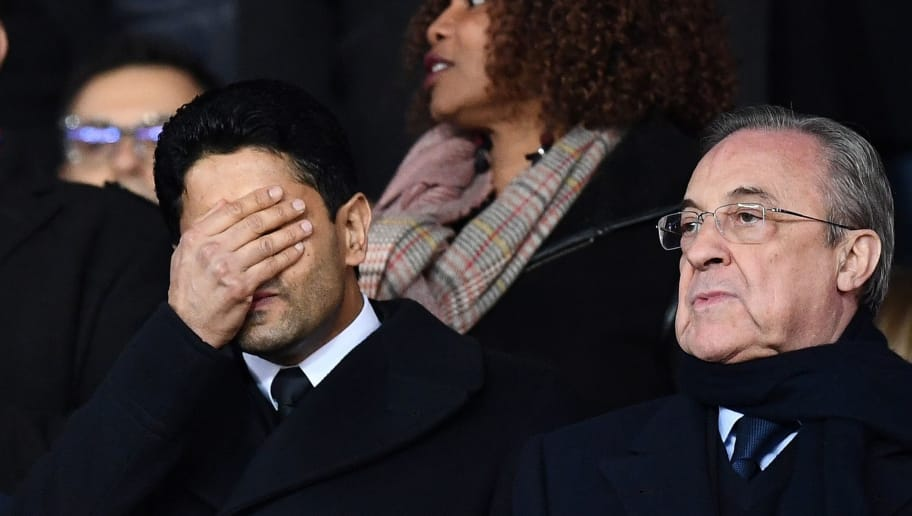TOPSHOT - Paris Saint-Germain's Qatari president Nasser Al-Khelaifi (L) grimaces next to Real Madrid's Spanish president Florentino Perez as they attend the UEFA Champions League round of 16 second leg football match between Paris Saint-Germain (PSG) and Real Madrid on March 6, 2018, at the Parc des Princes stadium in Paris.  / AFP PHOTO / FRANCK FIFE        (Photo credit should read FRANCK FIFE/AFP/Getty Images)