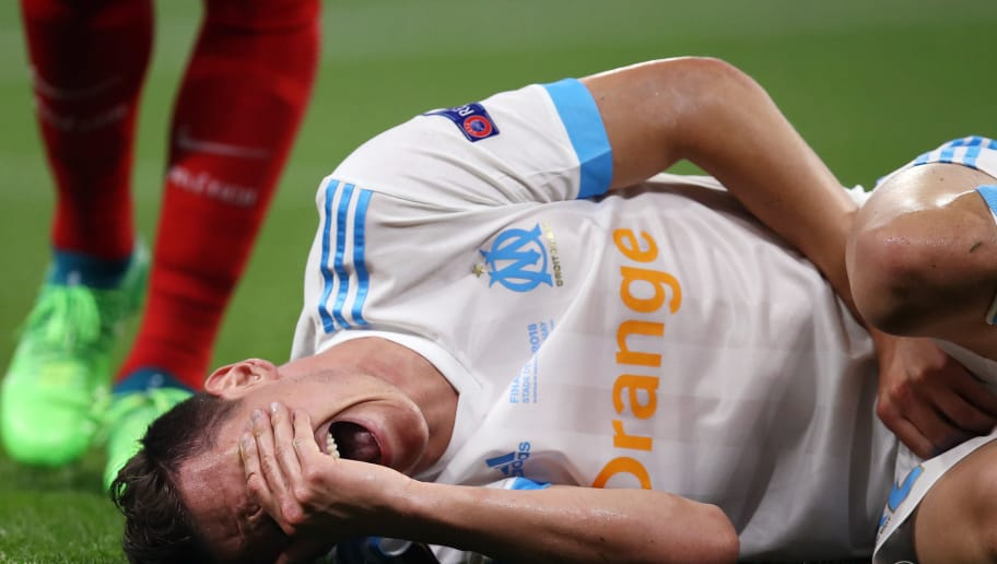 LYON, FRANCE - MAY 16:  Florian Thauvin of Marseille reacts after picking up an injury during the UEFA Europa League Final between Olympique de Marseille and Club Atletico de Madrid at Stade de Lyon on May 16, 2018 in Lyon, France.  (Photo by Maja Hitij/Getty Images)