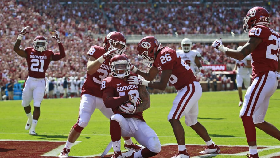 NORMAN, OK - SEPTEMBER 01: Linebacker Bryan Mead #38 and defensive back Caleb Murphy #26 congratulate linebacker Curtis Bolton #18 of the Oklahoma Sooners who recovered a blocked punt to score against the Florida Atlantic Owls at Gaylord Family Oklahoma Memorial Stadium on September 1, 2018 in Norman, Oklahoma. (Photo by Brett Deering/Getty Images)