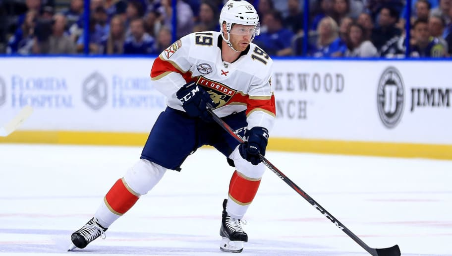 TAMPA, FL - OCTOBER 06:  Mike Matheson #19 of the Florida Panthers passes during Opening Night against the Tampa Bay Lightning at Amalie Arena on October 6, 2018 in Tampa, Florida.  (Photo by Mike Ehrmann/Getty Images)