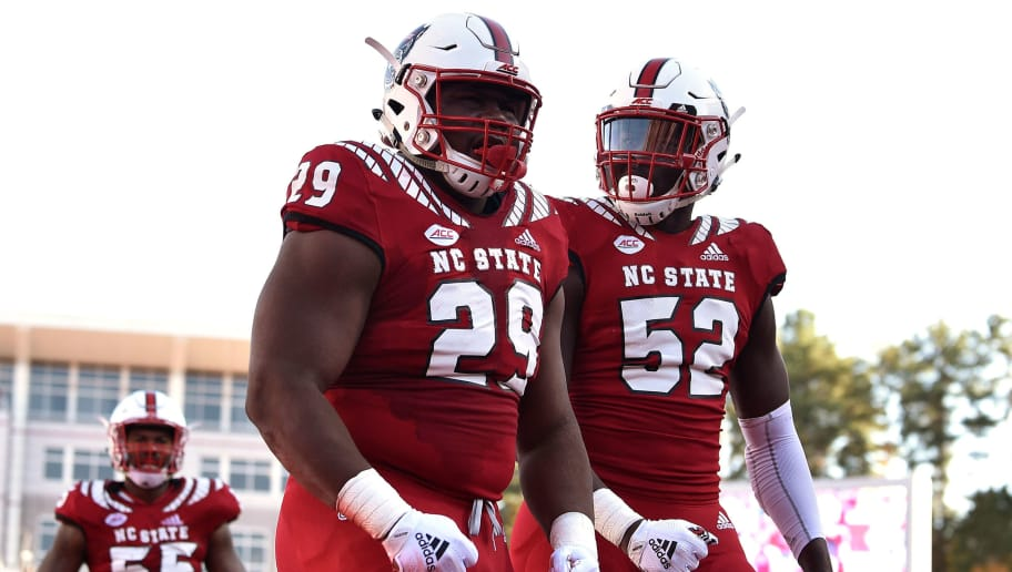 RALEIGH, NC - NOVEMBER 03: Ibrahim Kante #52 and Alim McNeill #29 of the North Carolina State Wolfpack react following a sack by McNeill against James Blackman of the Florida State Seminoles (not pictured) at Carter-Finley Stadium on November 3, 2018 in Raleigh, North Carolina. (Photo by Lance King/Getty Images)