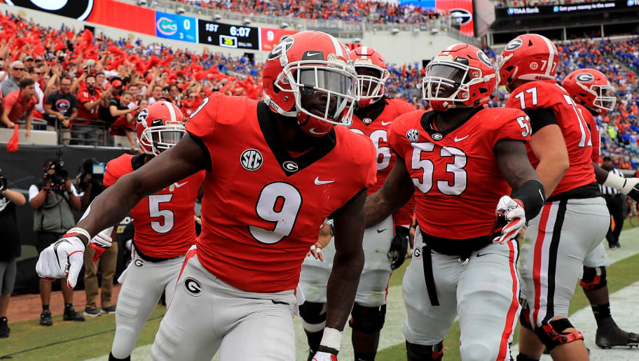 JACKSONVILLE, FL - OCTOBER 27:  Jeremiah Holloman #9 of the Georgia Bulldogs celebrates a touchdown during a game against the Florida Gators at TIAA Bank Field on October 27, 2018 in Jacksonville, Florida.  (Photo by Mike Ehrmann/Getty Images)