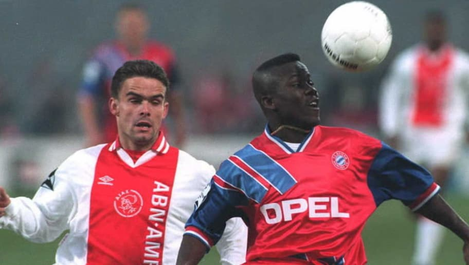 Marc Overmars(L) of Ajax Amsterdam and Osei Kuffour of Bayern Munich struggle for the ball during their Champions League soccer match 19 April. Ajax was in the lead 4-1 after 54 minutes of the match. AFP PHOTO (Photo by - / ANP / AFP)        (Photo credit should read -/AFP/Getty Images)