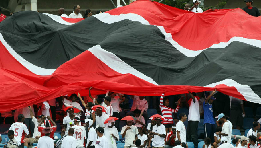 Football fans display a giant Trinidad and Tobago flag as they wait for their match against England to begin at the Hasley Crawford in Port of Spain on June 1, 2008. AFP PHOTO/Juan BARRETO (Photo credit should read JUAN BARRETO/AFP/Getty Images)