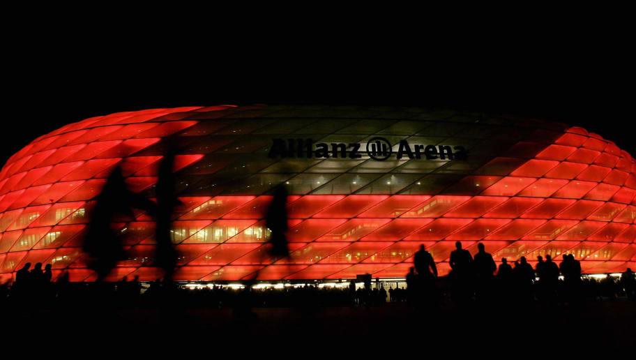 Football fans enter the Allianz-Arena st