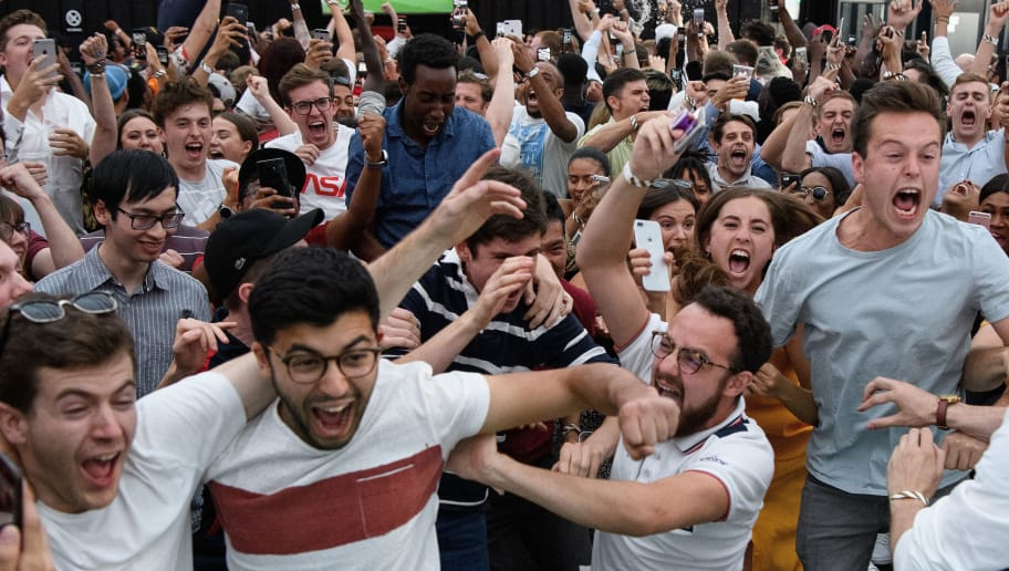 LONDON, ENGLAND - JULY 03:  Fans celebrate England's first goal of the match as they watch the FIFA 2018 World Cup Finals match between Colombia and England at Boxpark on July 3, 2018 in London, England. World Cup fever is building among England fans after reaching the Round of 16 in Russia.  (Photo by Leon Neal/Getty Images)