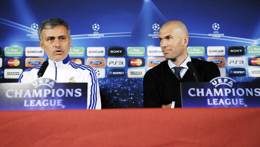 Former French football player Zinedine Zidane looks at Real Madrid's Portuguese coach Jose Mourinho (L) during a press conference on the eve of UEFA Champions league football match Lyon versus Real Madrid on February 21, 2011 at the Gerland stadium in Lyon.  AFP PHOTO/PHILIPPE DESMAZES (Photo credit should read PHILIPPE DESMAZES/AFP/Getty Images)