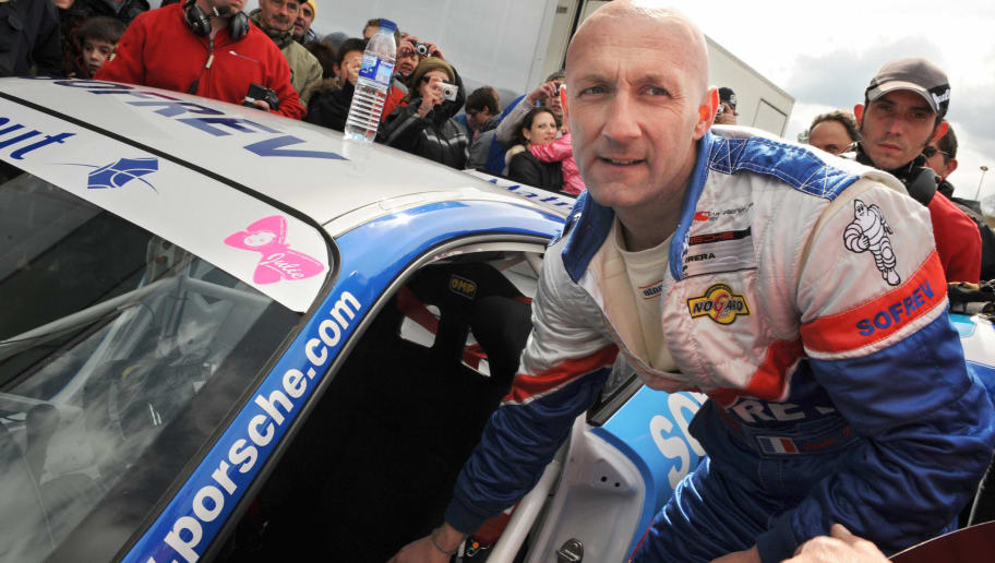 Former French football team goalkeeper Fabien Barthez gets ready to take the start of the Porsche Carrera Cup on the Nogaro ring, southwestern France on March 23, 2008.  Barthez ended his football professionnal career last April with Nantes team.  AFP PHOTO LIONEL BONAVENTURE (Photo credit should read LIONEL BONAVENTURE/AFP/Getty Images)