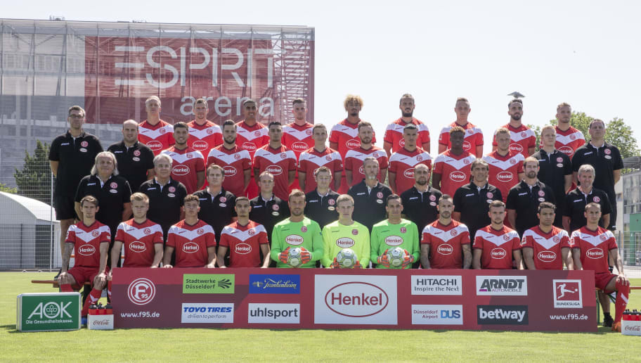 DUESSELDORF, GERMANY - JULY 13: The upper row (L-R) starts with Havard Nielsen, Oliver Fink, Aymen Barkok, Marvin Ducksch, Emmanuel Iyoha, Emir Kujovic, Robin Bormuth, Kenan Karaman, Andre Hoffmann. The second row (L-R) starts with kit manager Oliver Paashaus kit manager Benjamin Hauptmann, Goekhan Guel, Niko Giesselmann, Kaan Ayhan, Marcel Sobottka, Adam Bodzek, Alfredo Morales, Anderson Lucoqui, Rouwen Hennings, video analyst Philipp Grobelny, meant coach Axel Zehle. The third row (L-R) starts with docto Ulf Blecker, doctor Dr. Ulrich Keil, doctor Thomas Wieczorek, physiotherapist Thomas Gucek, physiotherapist Marcel Verstappen, chief physiotherapist Carsten Fiedler, athletic coach Robin Sanders, goalkeeper coach Claus Reitmaier, assistant coach Thomas Kleine, head ocach Friedhelm Funkel. The third row (L-R) starts with Benito Raman, Jean Zimmer, Taylan Duman, Georgios Siadas, Michael Rensing, Tim Wiesner, Raphael Wolf, Diego Contento, Kevin Stoeger, Kianz Froese, Davor Lovren of Fortuna Duesseldorf pose during the team presentation at Esprit Arena on July 13, 2018 in Duesseldorf, Germany. (Photo by Christof Koepsel/Bongarts/Getty Images)
