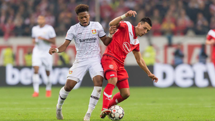 DUESSELDORF, GERMANY - SEPTEMBER 26: Leon Bailey of Bayer 04 Leverkusen and Kaan Ayhan of Fortuna Duesseldorf battle for the ball during the Bundesliga match between Fortuna Duesseldorf and Bayer 04 Leverkusen at Esprit-Arena on September 26, 2018 in Duesseldorf, Germany. (Photo by TF-Images/Getty Images)