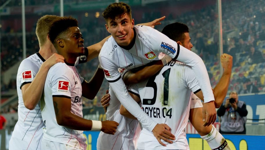DUESSELDORF, GERMANY - SEPTEMBER 26: Kevin Volland of Bayer 04 Leverkusen celebrates after scoring his team`s second goal with Kai Havertz of Bayer 04 Leverkusen during the Bundesliga match between Fortuna Duesseldorf and Bayer 04 Leverkusen at Merkur Spiel-Arena on September 26, 2018 in Duesseldorf, Germany. (Photo by TF-Images/Getty Images)