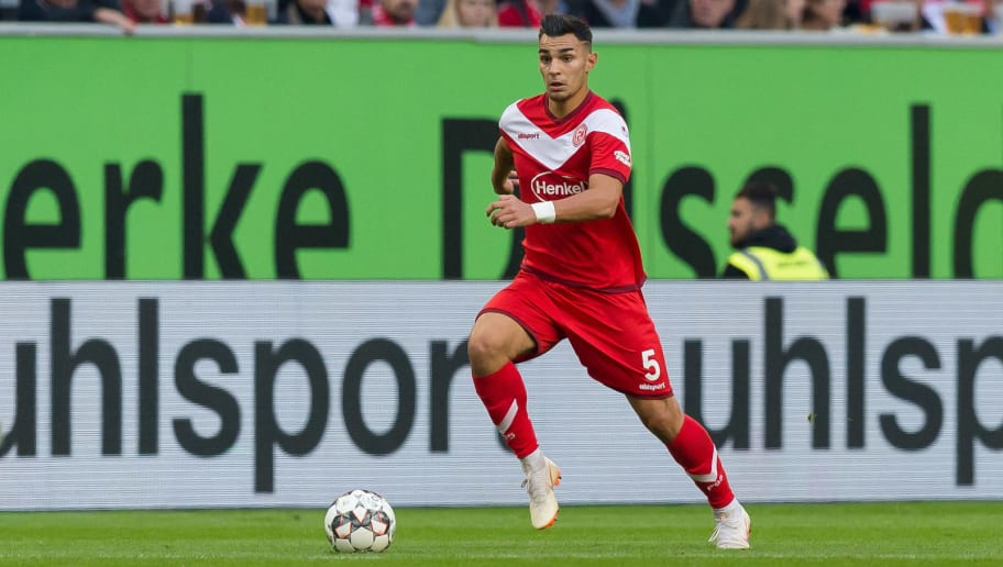 DUESSELDORF, GERMANY - SEPTEMBER 26: Kaan Ayhan of Fortuna Duesseldorf controls the ball during the Bundesliga match between Fortuna Duesseldorf and Bayer 04 Leverkusen at Merkur Spiel-Arena on September 26, 2018 in Duesseldorf, Germany. (Photo by TF-Images/Getty Images)