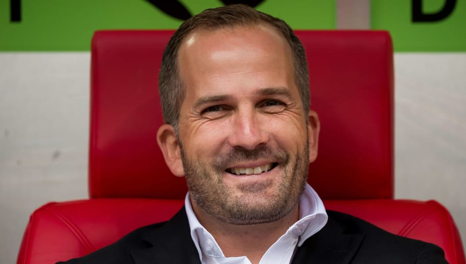 DUESSELDORF, GERMANY - AUGUST 25: Head coach Manuel Baum of FC Augsburg laughs prior to the Bundesliga match between Fortuna Duesseldorf and FC Augsburg at Esprit-Arena on August 25, 2018 in Duesseldorf, Germany. (Photo by TF-Images/Getty Images)